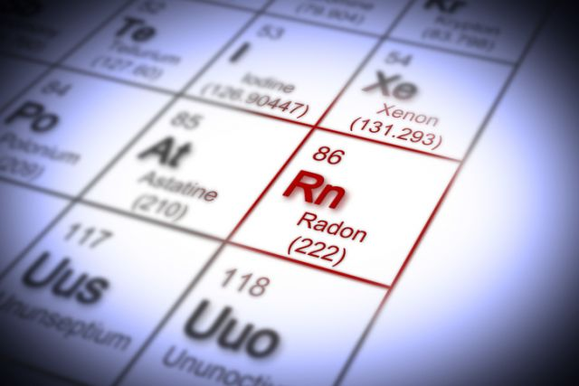 The danger of radon gas in our homes - concept image with periodic table of the elements