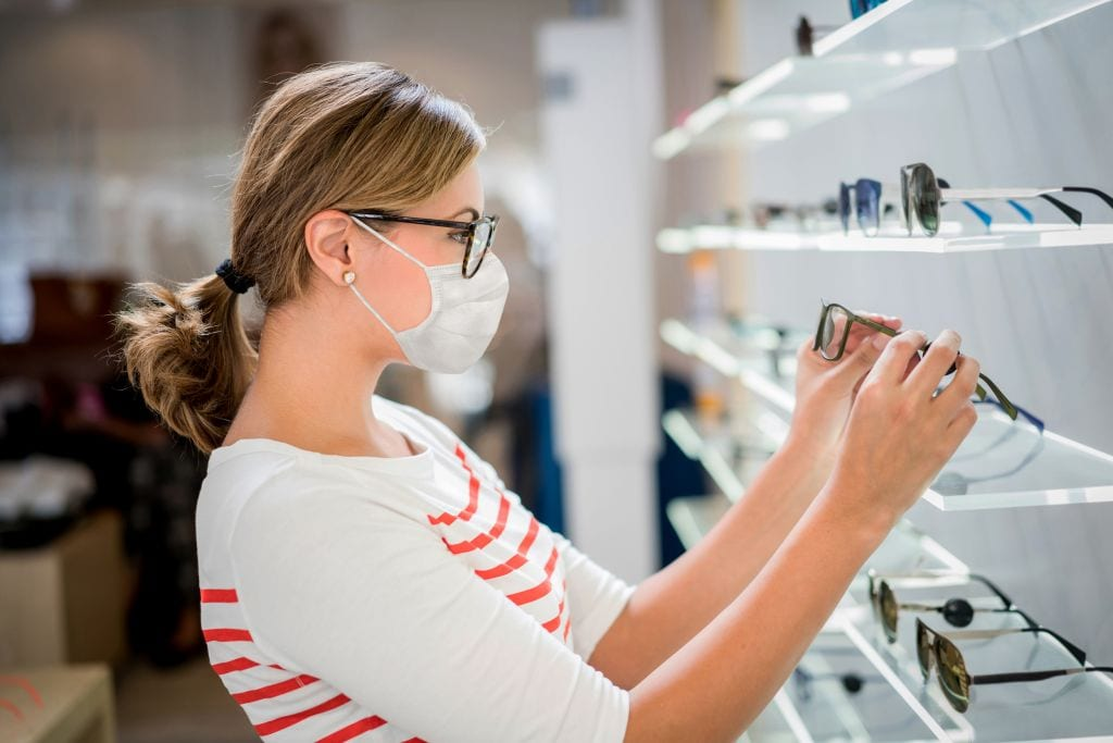 Woman browsing frames in opticians